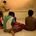 Children learning English in detention
