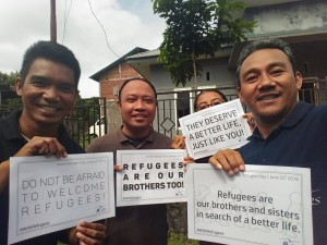 JRS Manado team posing with their  #WithRefugees World Refugee Day messages